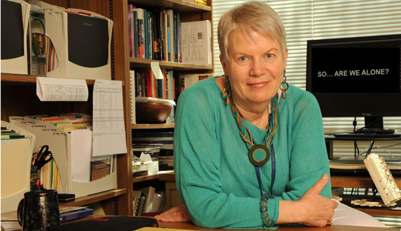 Dr. Jill Tarter Leaning against her desk in her office
